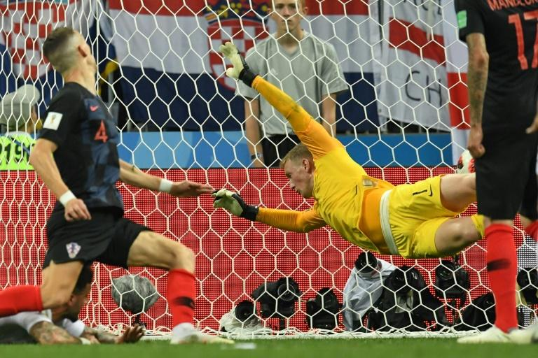 Croatia forward Ivan Perisic scores past England's Jordan Pickford during their World Cup semi-final in Moscow