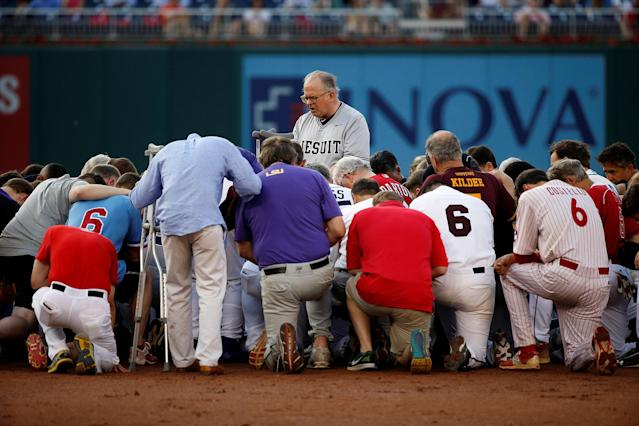 <p>Patrick Conroy, Chaplain of the House of Representatives, leads Democrats and Republicans in prayer before they face off in the annual Congressional Baseball Game at Nationals Park in Washington, June 15, 2017. (Photo: Joshua Roberts/Reuters) </p>