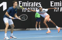 Rajeev Ram, right, of the US and Britain's Joe Salisbury in action against Croatia's Ivan Dodig and Slovakia's Filip Polasek in the men's doubles final at the Australian Open tennis championship in Melbourne, Australia, Sunday, Feb. 21, 2021.(AP Photo/Andy Brownbill)