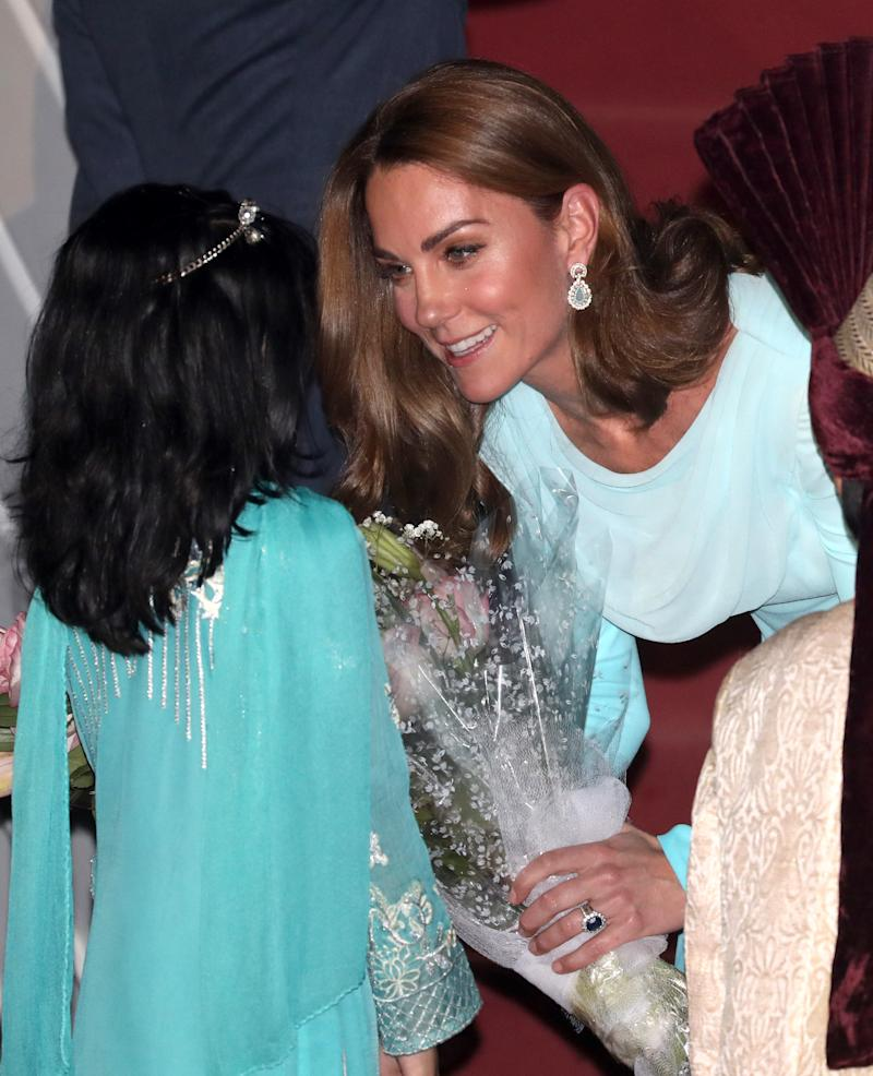 The Duchess also accessorised with statement teal earrings. [Photo: Getty]