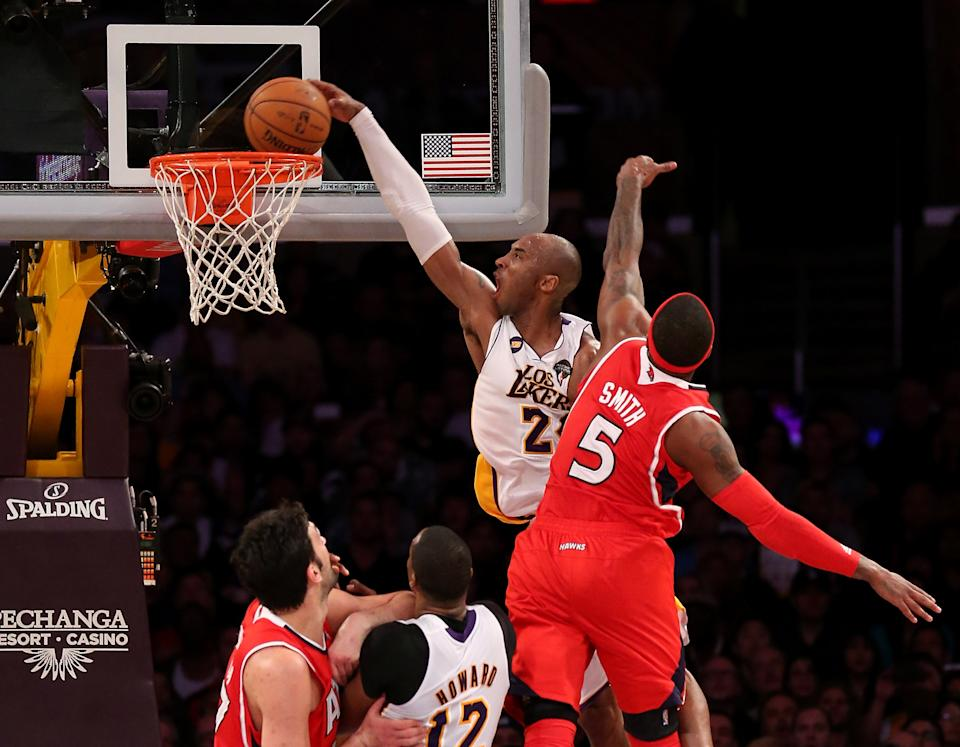 LOS ANGELES, CA - MARCH 03:  Kobe Bryant #24 of the Los Angeles Lakers dunks over Josh Smith #5 of the Atlanta Hawks at Staples Center on March 3, 2013 in Los Angeles, California. The Lakers won 99-98. NOTE TO USER: User expressly acknowledges and agrees that, by downloading and or using this photograph, User is consenting to the terms and conditions of the Getty Images License Agreement.  (Photo by Stephen Dunn/Getty Images)