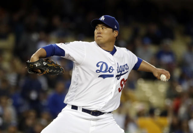 Los Angeles Dodgers starting pitcher Hyun-Jin Ryu throws to the San Francisco Giants during the first inning of a baseball game Tuesday, April 2, 2019, in Los Angeles. (AP Photo/Marcio Jose Sanchez)