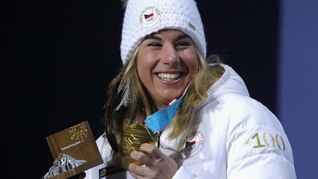 Ester Ledecka made history by adding a snowboard gold to the super-G title she claimed last weekend in Pyeongchang.