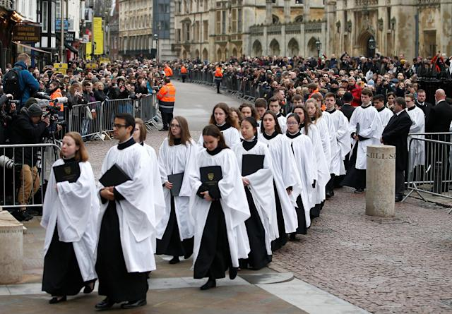 <p>Members of the church choir arrive at Great St Marys Church, where the funeral of theoretical physicist Prof Stephen Hawking is being held, in Cambridge, Britain, March 31, 2018. (Photo: Henry Nicholls/Reuters) </p>