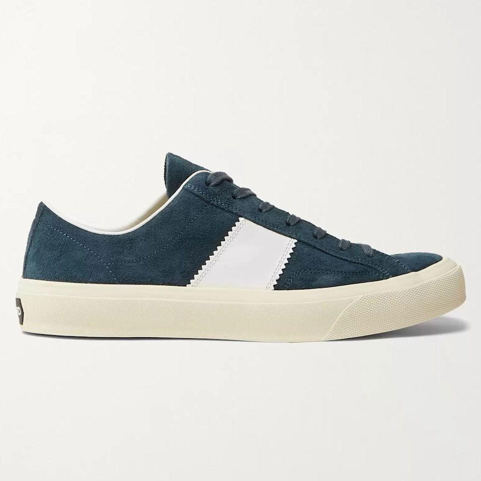 """<p><strong>Cambridge Sneakers</strong></p><p>mrporter.com</p><p><strong>$890.00</strong></p><p><a href=""""https://go.redirectingat.com?id=74968X1596630&url=https%3A%2F%2Fwww.mrporter.com%2Fen-us%2Fmens%2Fproduct%2Ftom-ford%2Fshoes%2Flow-top-sneakers%2Fcambridge-leather-trimmed-suede-sneakers%2F46353151654297626&sref=https%3A%2F%2Fwww.esquire.com%2Fstyle%2Fmens-accessories%2Fadvice%2Fg2538%2Fluxury-sneaker-brands-worth-spending-money%2F"""" rel=""""nofollow noopener"""" target=""""_blank"""" data-ylk=""""slk:Shop Now"""" class=""""link rapid-noclick-resp"""">Shop Now</a></p><p>Tom Ford, the brand, is absolutely steeped in luxury. Makes sense; Tom Ford, the man, is <em>also</em> absolutely steeped in luxury. And it could go without saying, but just in case: His sneakers are, too. The Cambridge is made in Italy from soft-as-hell suede and finished with a now-signature Ford design detail: a zig-zag-edged side stripe that's something of a calling card for other in-the-know sneaker fans.</p>"""