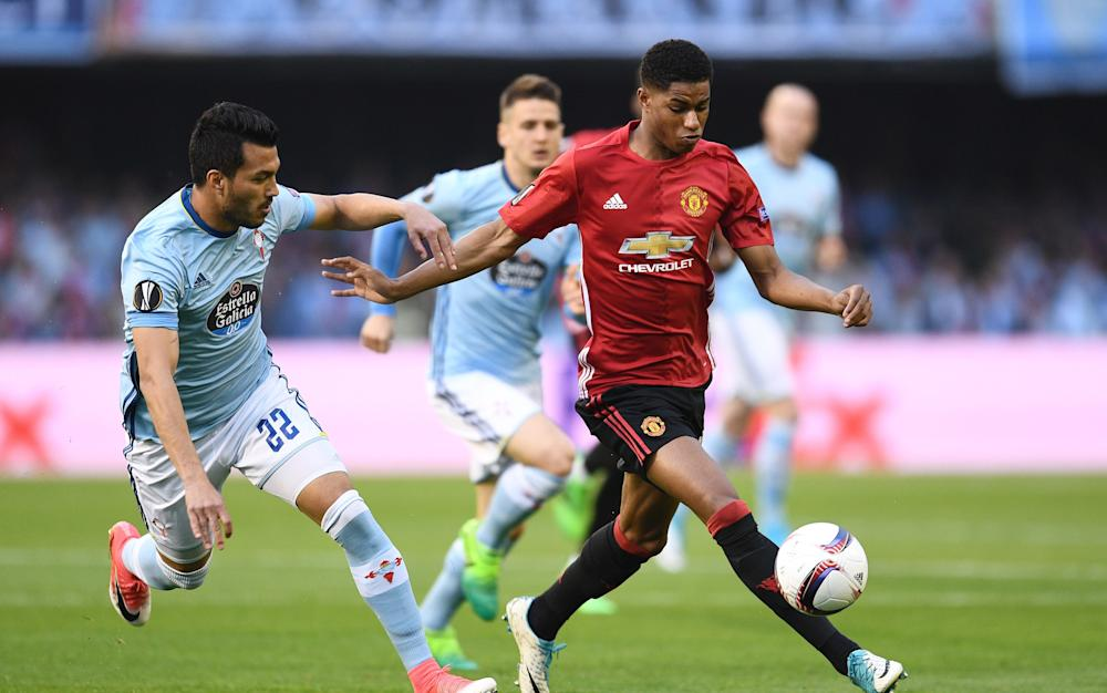 Marcus Rashford of Manchester United holds off Gustavo Cabral - Credit: GETTY IMAGES