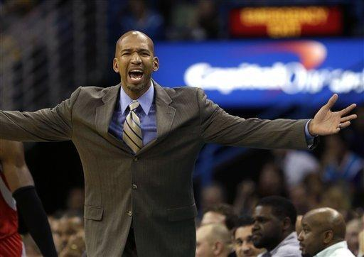 New Orleans Hornets head coach Monty Williams reacts to the officials in the first half of an NBA basketball game against the Houston Rockets in New Orleans, Friday, Jan. 25, 2013. (AP Photo/Gerald Herbert)