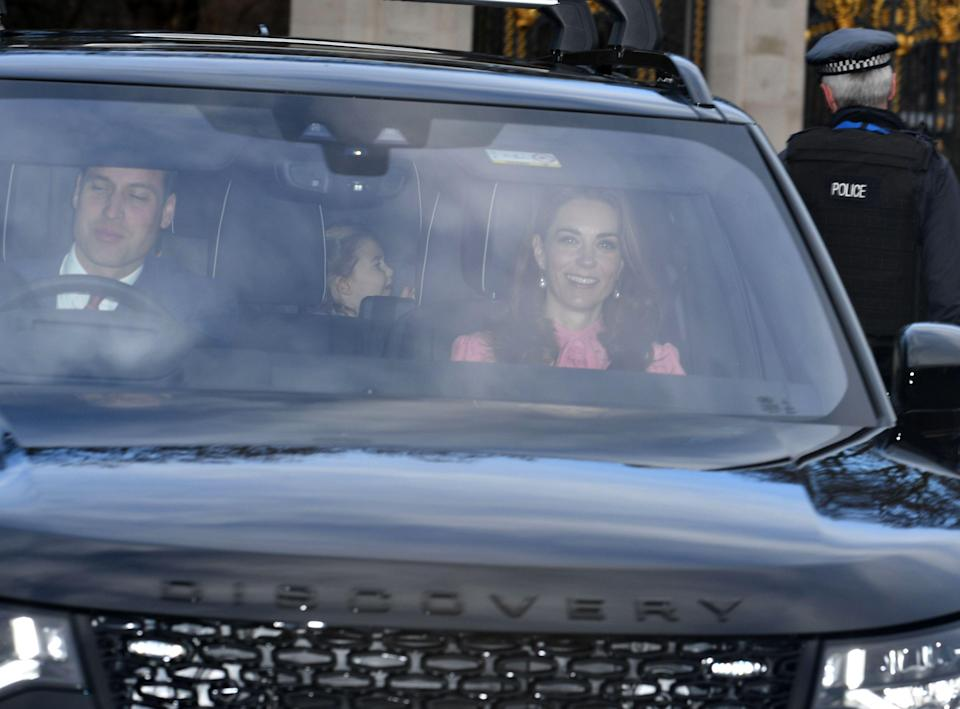 <p>The Duke and Duchess of Cambridge arrive. Princess Charlotte can be seen in the back of the car [Photo: Rex </p>