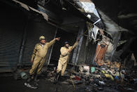 Fire fighters douse a fire at Gokul Puri tyre market which was burnt in Tuesday's violence in New Delhi, India, Wednesday, Feb. 26, 2020. At least 20 people were killed in three days of clashes in New Delhi, with the death toll expected to rise as hospitals were overflowed with dozens of injured people, authorities said Wednesday. The clashes between Hindu mobs and Muslims protesting a contentious new citizenship law that fast-tracks naturalization for foreign-born religious minorities of all major faiths in South Asia except Islam escalated Tuesday. (AP Photo/Altaf Qadri)