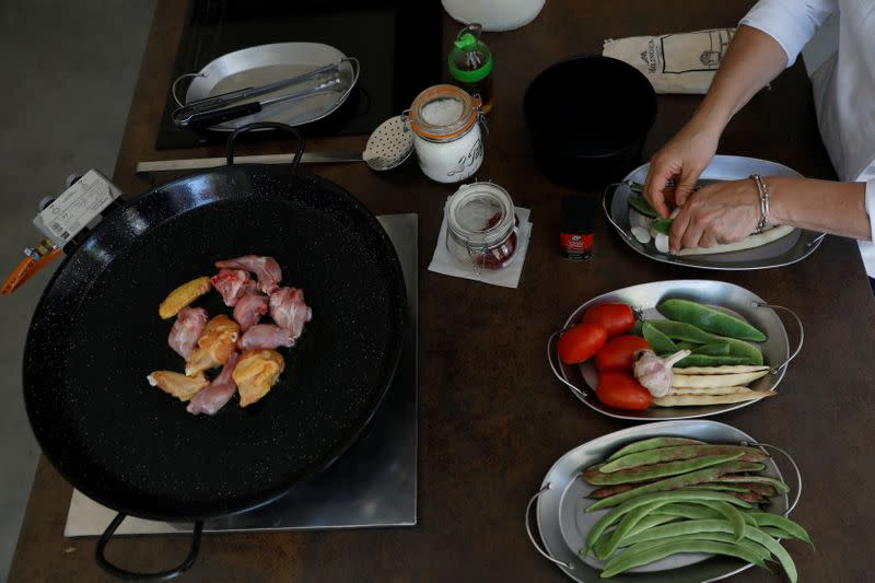 Chef Maria Munoz prepares a traditional paella during a demonstration in her cooking school Cocinea in Madrid