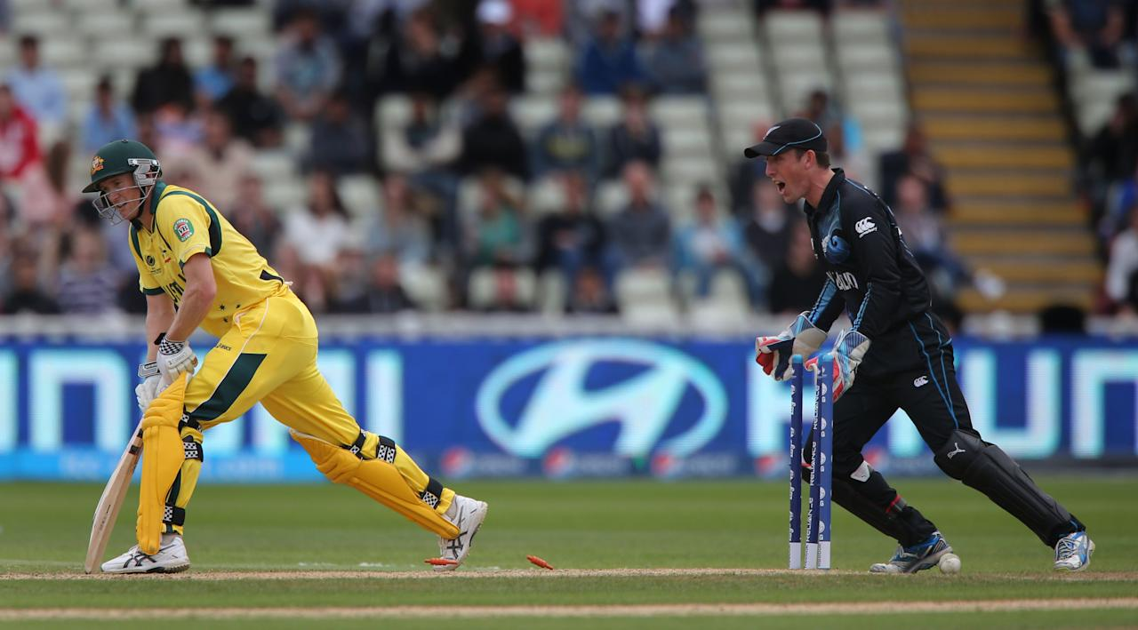Australia's George Bailey is out for 55 bowled by New Zealand's Nathan McCullum as wicketkeeper Luke Ronchi celebrates during the ICC Champions Trophy match at Edgbaston, Birmingham.
