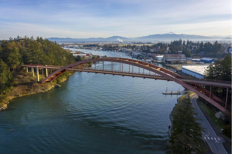 """<p> You'll spot the famed Rainbow Bridge as you cross into this town located in the Skagit Valley. With only 900 residents, La Conner gets bustling in the spring with tourists who flock to its annual <a href=""""https://lovelaconner.com/skagit-valley-tulip-festival-2021/"""" rel=""""nofollow noopener"""" target=""""_blank"""" data-ylk=""""slk:tulip festival"""" class=""""link rapid-noclick-resp"""">tulip festival</a>. </p>"""