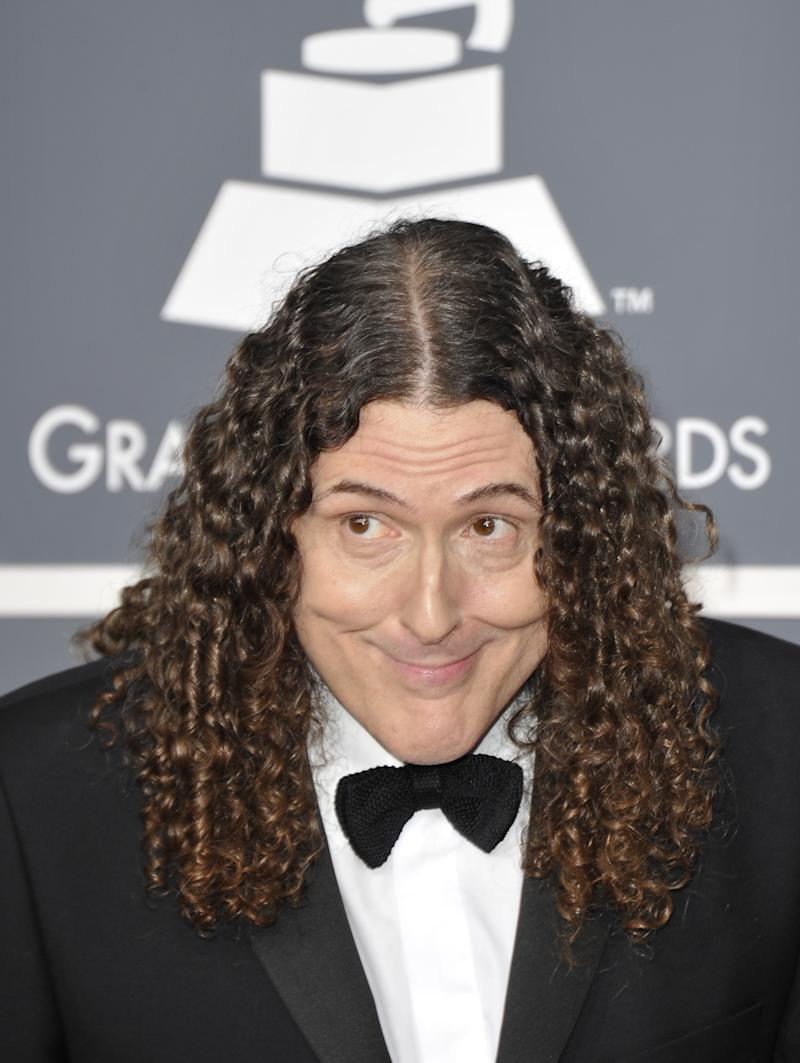 """US comedian-singer """"Weird Al"""" Yankovic has scored a career-first number one album following a viral video campaign parodying two of the biggest hits of the past year"""
