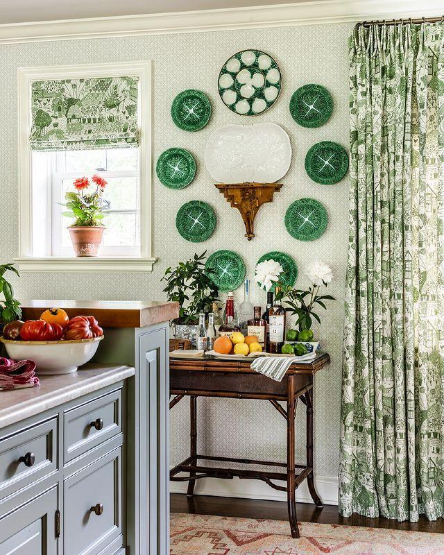 """<p><a href=""""https://www.housebeautiful.com/design-inspiration/a29652925/how-to-hang-plates-on-wall/"""" rel=""""nofollow noopener"""" target=""""_blank"""" data-ylk=""""slk:Wall-hung plates"""" class=""""link rapid-noclick-resp"""">Wall-hung plates </a>add extra pop to this verdant kitchen. </p><p><a href=""""https://www.instagram.com/p/CMhamllB3hx/"""" rel=""""nofollow noopener"""" target=""""_blank"""" data-ylk=""""slk:See the original post on Instagram"""" class=""""link rapid-noclick-resp"""">See the original post on Instagram</a></p>"""