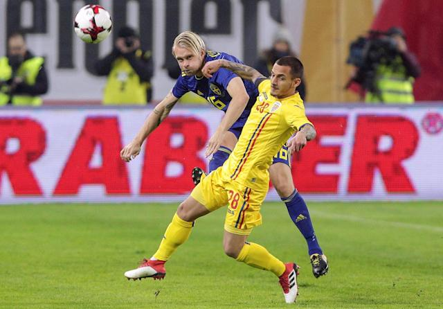 Soccer Football - International Friendly - Romania vs Sweden - National Arena, Craiova, Romania - March 27, 2018 Sweden's Johan Larsson in action with Romania's Alexandru Mitrita Inquam Photos/Octav Ganea via REUTERS ROMANIA OUT. NO COMMERCIAL OR EDITORIAL SALES IN ROMANIA THIS IMAGE HAS BEEN SUPPLIED BY A THIRD PARTY. IT IS DISTRIBUTED, EXACTLY AS RECEIVED BY REUTERS, AS A SERVICE TO CLIENTS