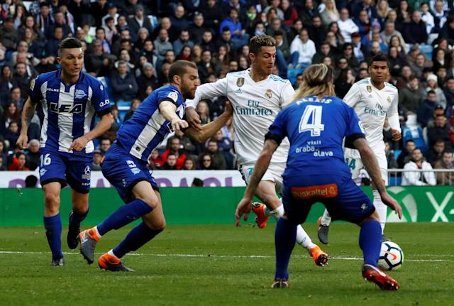 Soccer Football - La Liga Santander - Real Madrid vs Deportivo Alaves - Santiago Bernabeu, Madrid, Spain - February 24, 2018 Real Madrid's Cristiano Ronaldo scores their first goal REUTERS/Juan Medina