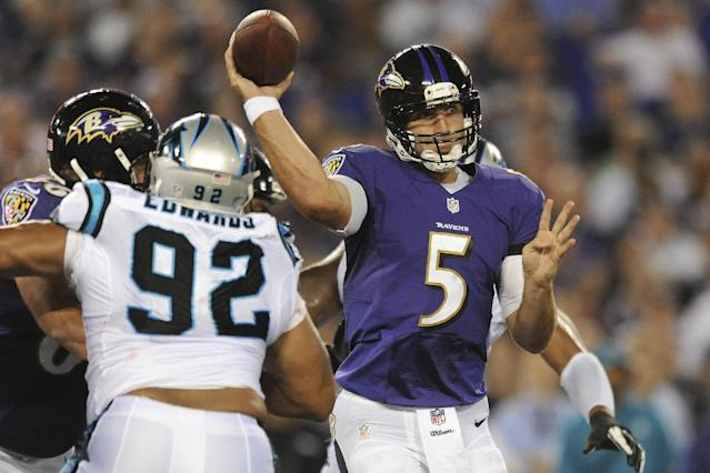 Baltimore Ravens quarterback Joe Flacco passes the ball during the first half of a preseason NFL football game against the Carolina Panthers in Baltimore, Thursday, Aug. 22, 2013. (AP Photo/Gail Burton)