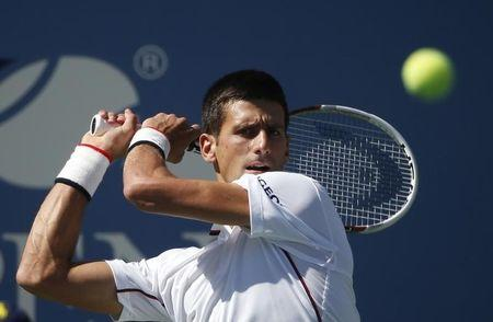 Novak Djokovic of Serbia hits a return to Paul-Henri Mathieu of France during their match at the 2014 U.S. Open tennis tournament in New York, August 28, 2014. REUTERS/Mike Segar