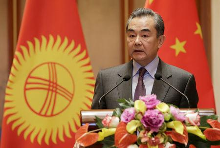 Chinese Foreign Minister Wang Yi attends a joint news conference with Kyrgyzstan's Foreign Minister Chyngyz Aidarbekov in Beijing