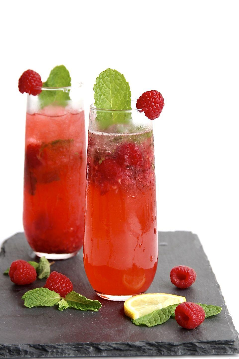 """<p>Beat the summer heat with muddled mint, raspberries, lemon, simple syrup, rum, and a splash of prosecco. </p><p>Get the recipe at <a href=""""https://thebakermama.com/recipes/sparkling-raspberry-mojitos/"""" rel=""""nofollow noopener"""" target=""""_blank"""" data-ylk=""""slk:The Baker Mama"""" class=""""link rapid-noclick-resp"""">The Baker Mama</a>.</p>"""