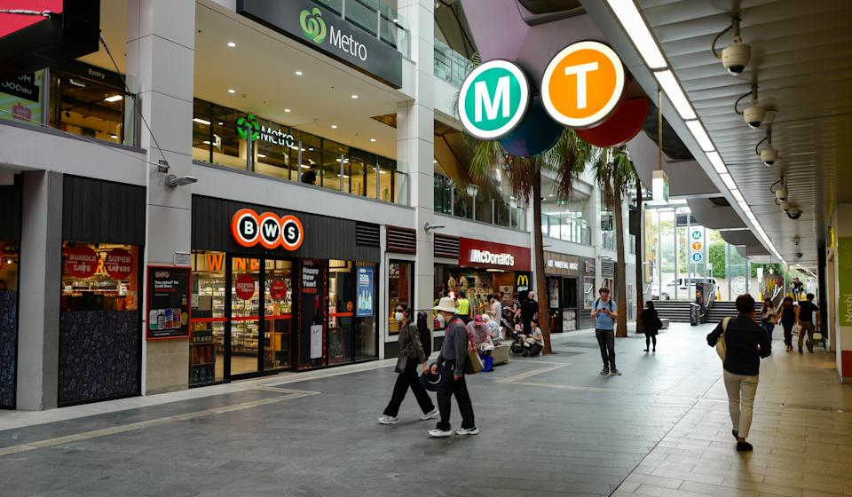 People out in the suburb of Chatswood wearing face masks.