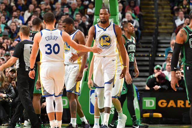 The Golden State Warriors held on in the final minutes on Saturday night to beat the Boston Celtics at TD Garden. (Jesse D. Garrabrant/Getty Images)