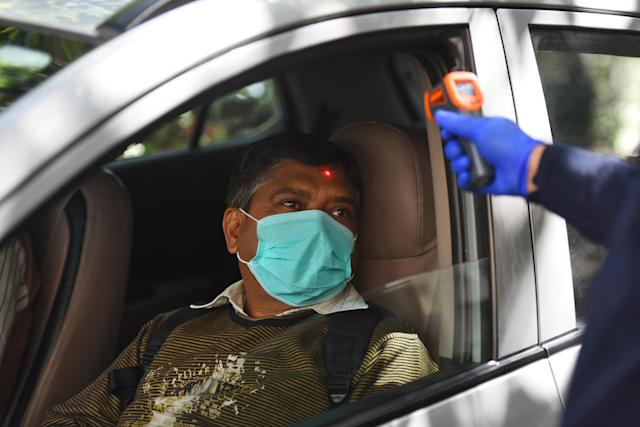 A car driver goes through thermal screening amid the coronavirus scare.