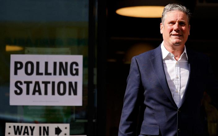 Starmer: Dogged at polling stations - AFP