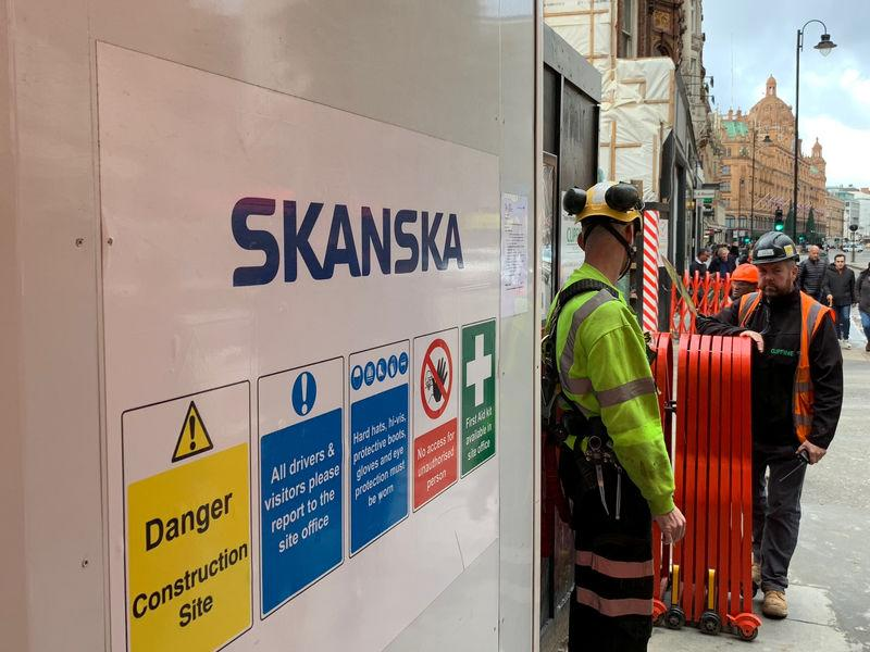 FILE PHOTO: Swedish builder Skanska sign is seen at the building site on Brompton Road in London, Britain November 7, 2018. REUTERS/Anna Ringstrom