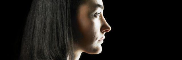 profile portrait of a woman with dark hair