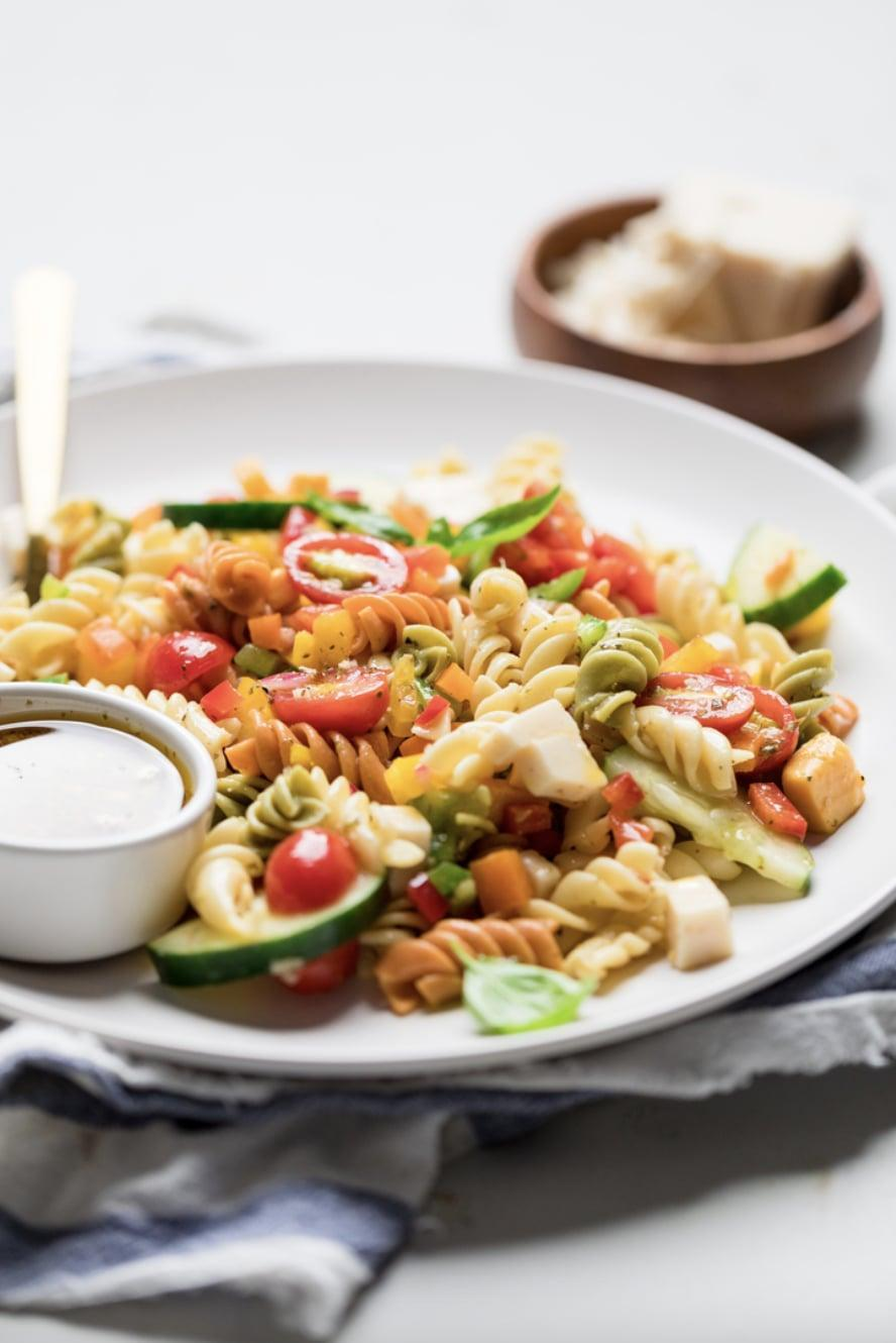 """<p>Made with a zesty homemade Italian dressing, this pasta salad will wake up your taste buds. It takes less than 20 minutes to make, and can be made in big batches. Enjoy it with burgers, sandwiches, and more.</p> <p><strong>Get the recipe:</strong> <a href=""""https://makeitdairyfree.com/italian-vegan-pasta-salad/"""" class=""""link rapid-noclick-resp"""" rel=""""nofollow noopener"""" target=""""_blank"""" data-ylk=""""slk:Italian vegan pasta salad"""">Italian vegan pasta salad</a></p>"""