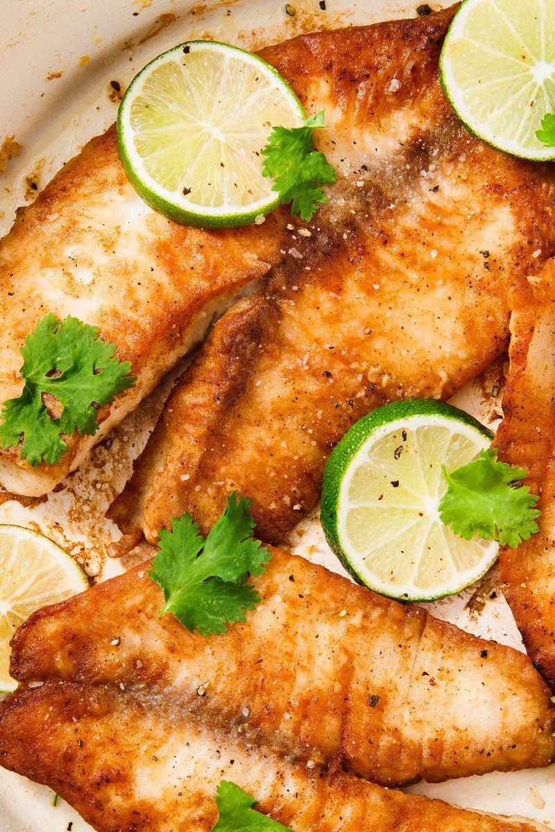 """<p>Tilapia can get a bad wrap. It's not tender and fatty like <a href=""""https://www.delish.com/uk/salmon-recipes/"""" rel=""""nofollow noopener"""" target=""""_blank"""" data-ylk=""""slk:salmon"""" class=""""link rapid-noclick-resp"""">salmon</a>, nor is it firm and flavourful like <a href=""""https://www.delish.com/uk/cooking/recipes/a29869428/seared-ahi-tuna-steak-recipe/"""" rel=""""nofollow noopener"""" target=""""_blank"""" data-ylk=""""slk:tuna"""" class=""""link rapid-noclick-resp"""">tuna</a>. It's sort of an in-between <a href=""""https://www.delish.com/uk/fish-recipes/"""" rel=""""nofollow noopener"""" target=""""_blank"""" data-ylk=""""slk:fish"""" class=""""link rapid-noclick-resp"""">fish</a>, and can often be written off as boring. No more! We're here to vouch for tilapia; it has so much to offer! It's lean and inexpensive, making it a great choice for your next weeknight dinner.</p><p>Get the <a href=""""https://www.delish.com/uk/cooking/recipes/a30493059/pan-fried-tilapia-recipe/"""" rel=""""nofollow noopener"""" target=""""_blank"""" data-ylk=""""slk:Pan-Fried Tilapia"""" class=""""link rapid-noclick-resp"""">Pan-Fried Tilapia</a> recipe.</p>"""