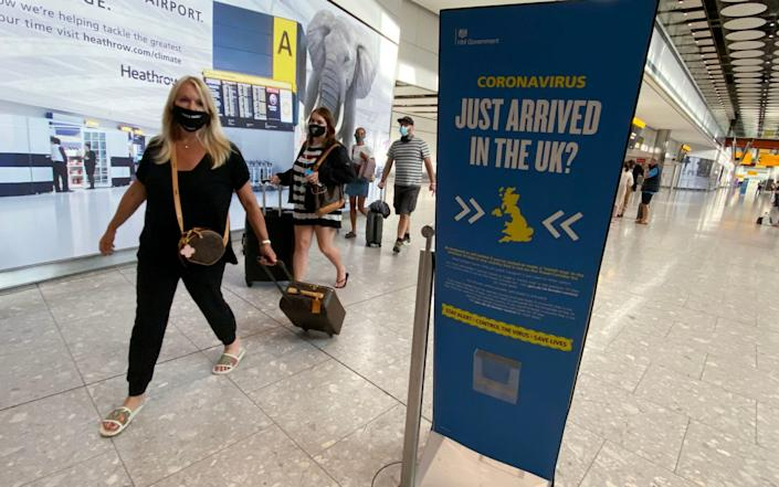 Passengers arrive at Heathrow Airport as they return from Greece after Government changes to the quarantine list. - Yui Mok/PA