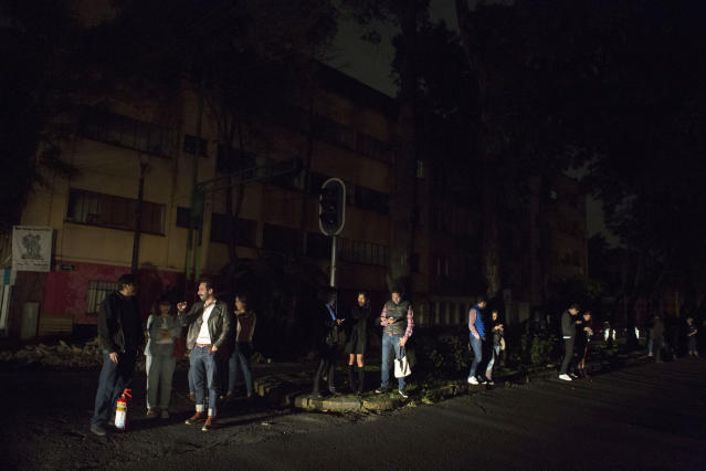 <p>People who evacuated from bars during an earthquake stand in the street in La Roma neighborhood of Mexico City, sections of which lost power, just before midnight on Thursday, Sept. 7, 2017. (AP Photo/Rebecca Blackwell) </p>