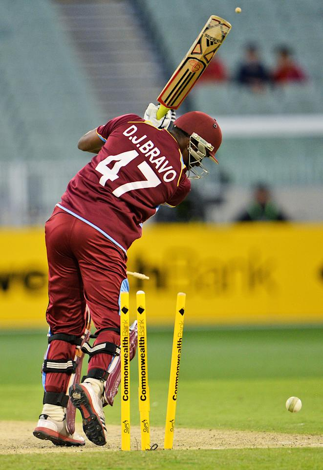 West Indies batsman Dwayne Bravo is bowled by Australian paceman Mitchell Johnson in their one-day cricket international played at the Melbourne Cricket Ground (MCG), on February 10, 2013.  AFP PHOTO/William WEST  IMAGE RESTRICTED TO EDITORIAL USE - STRICTLY NO COMMERCIAL USE        (Photo credit should read WILLIAM WEST/AFP/Getty Images)