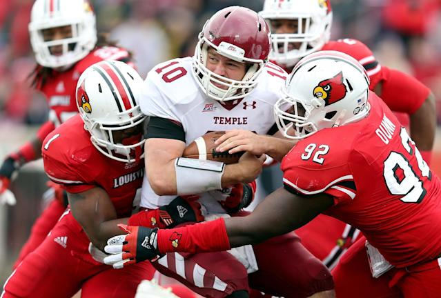 LOUISVILLE, KY - NOVEMBER 03: Chris Coyer #10 of the Temple Owls is sacked by Keith Brown #1 and Brandon Dunn #92 of the Louisville Cardinals during the game at Papa John's Cardinal Stadium on November 3, 2012 in Louisville, Kentucky. (Photo by Andy Lyons/Getty Images)