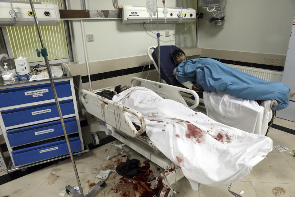 Afghan school students are treated at a hospital after a bomb explosion near a school west of Kabul, Afghanistan, Saturday, May 8, 2021. A bomb exploded near a school in west Kabul on Saturday, killing several people, many them young students, an Afghan government spokesmen said. (AP Photo/Rahmat Gul)