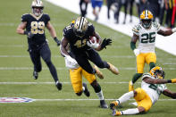 New Orleans Saints running back Alvin Kamara (41) is tackled by Green Bay Packers strong safety Adrian Amos on a 49 yard run in the first half of an NFL football game against the Green Bay Packers in New Orleans, Sunday, Sept. 27, 2020. (AP Photo/Brett Duke)