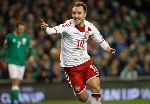 FILE - In this Tuesday, Nov. 14, 2017 filer, Denmark's Christian Eriksen celebrates after scoring his side's third goal during the World Cup qualifying play off second leg soccer match between Ireland and Denmark at the Aviva Stadium in Dublin. (AP Photo/Peter Morrison, File)