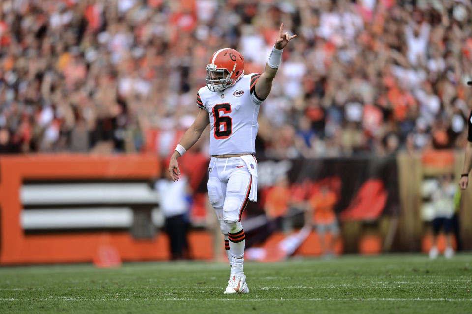 Cleveland Browns quarterback Baker Mayfield celebrates as running back Kareem Hunt scores a 29-yard touchdown during the second half of an NFL football game against the Chicago Bears, Sunday, Sept. 26, 2021, in Cleveland. (AP Photo/David Dermer)