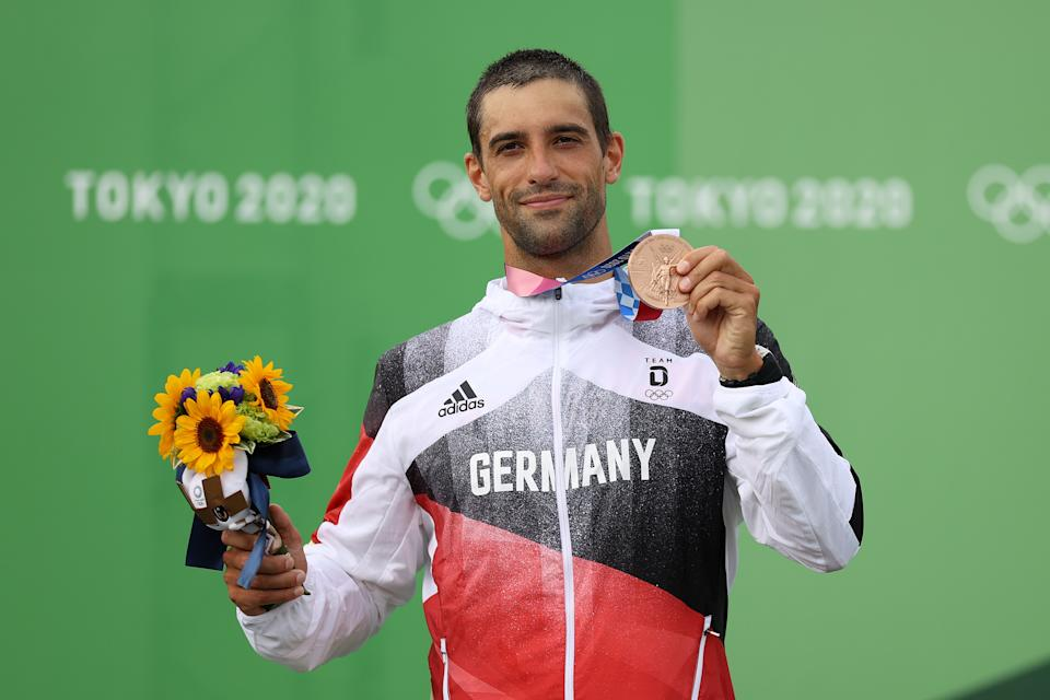 TOKYO, JAPAN - JULY 30: Bronze medalist Hannes Aigner of Team Germany poses with his medal following the Men's Kayak Slalom Final on day seven of the Tokyo 2020 Olympic Games at Kasai Canoe Slalom Centre on July 30, 2021 in Tokyo, Japan. (Photo by Naomi Baker/Getty Images)