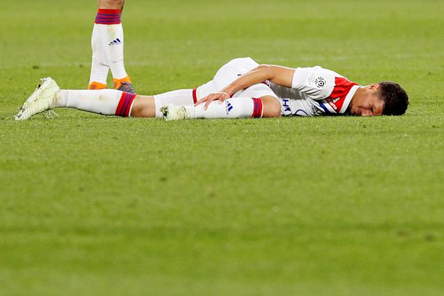 Soccer Football - Ligue 1 - Olympique Lyonnais vs OGC Nice - Groupama Stadium, Lyon, France - May 19, 2018 Lyon's Houssem Aouar after sustaining an injury REUTERS/Emmanuel Foudrot