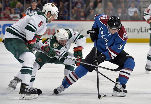 Colorado Avalanche center Matt Duchene (9) skates against Minnesota Wild center Torrey Mitchell (17) and Marco Scandella (6) during the first period of an NHL hockey game on Saturday, Nov. 30, 2013, in Denver. (AP Photo/Jack Dempsey)