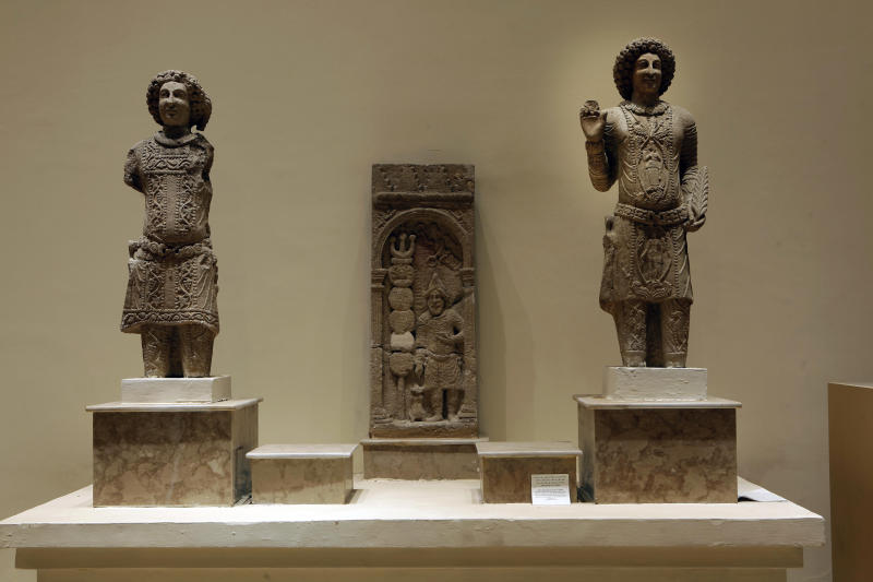 In this Wednesday, April 3, 2013 photo, stone figures depicting the family of Sanatruq the 1st, found at Hatra is displayed at the Iraqi National Museum in Baghdad, Iraq. Ten years after Iraq's national museum was looted and smashed by frenzied thieves during the U.S.-led invasion in 2003 to topple Saddam Hussein, it's still far from ready for a public re-opening. Work to overcome decades of neglect and the destruction of war has been hindered by power struggles, poorly-skilled staff and the persistent violence plaguing the country, said Bahaa Mayah, Iraq's most senior antiquities official. (AP Photo/Hadi Mizban)