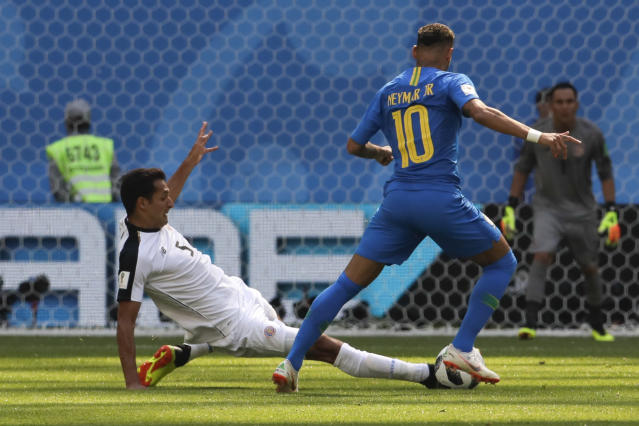 Brazil's Neymar, right, and Costa Rica's Celso Borges challenge for the ball during the group E match between Brazil and Costa Rica at the 2018 soccer World Cup in the St. Petersburg Stadium in St. Petersburg, Russia, Friday, June 22, 2018. (AP Photo/Dmitri Lovetsky)