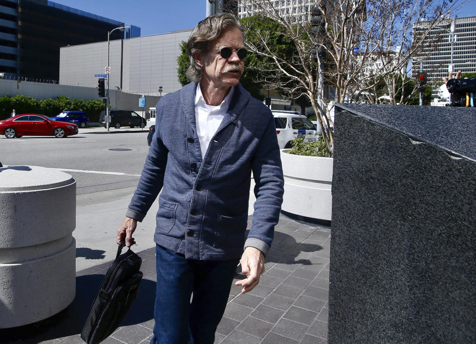 William H. Macy arrived in court Tuesday to support his wife, Felicity Huffman. According to court papers, he was aware of his wife's involvement in the scam, but he has avoided an arrest at this point. (Photo: AP Images)
