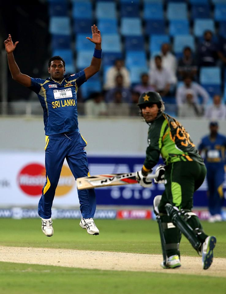 DUBAI, UNITED ARAB EMIRATES - DECEMBER 11:  Angelo Mathews reacts during the first Twenty20 International match between Pakistan and Sri Lanka at Dubai Sports City Cricket Stadium on December 11, 2013 in Dubai, United Arab Emirates.  (Photo by Francois Nel/Getty Images)
