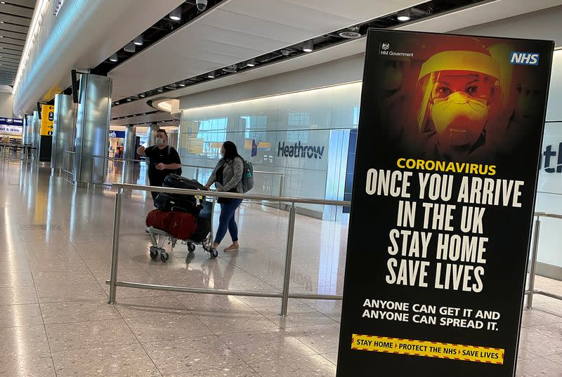 Passengers arrive from international flights at Heathrow Airport in London