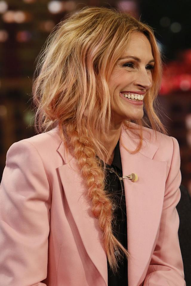 <p>The actress debuted a new rose gold hair colour on Jimmy Kimmel Live. Roberts opted for a messy peach/pink plait that perfectly matched her candyfloss-coloured suit.</p>