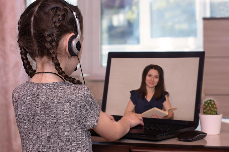 Screens have helped children learn and stay connected during lockdown, but too much time on devices can be harmful (Posed by model, Getty Images)